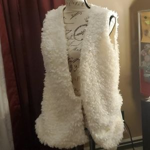 Lib faux lamb skin lined med. Weight  vest